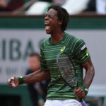 PARIS, FRANCE - MAY 31:  Gael Monfils of France celebrates set point in the second set in his Men's Singles match against Roger Federer of Switzerland on day eight of the 2015 French Open at Roland Garros on May 31, 2015 in Paris, France.  (Photo by Clive Brunskill/Getty Images)