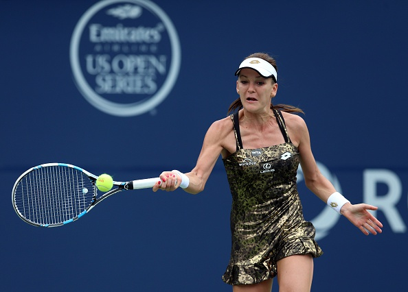 TORONTO, ON - AUGUST 14:  Agnieszka Radwanska of Poland plays a shot against Simona Halep of Romania during Day 5 of the Rogers Cup at the Aviva Centre on August 14, 2015 in Toronto, Ontario, Canada.  (Photo by Vaughn Ridley/Getty Images)