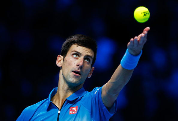 LONDON, ENGLAND - NOVEMBER 22:  Novak Djokovic of Serbia serves during the men's singles final against Roger Federer of Switzerland on day eight of the Barclays ATP World Tour Finals at the O2 Arena on November 22, 2015 in London, England.  (Photo by Julian Finney/Getty Images)