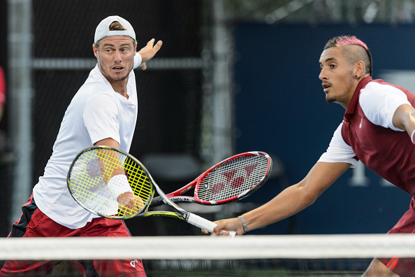 MONTREAL, ON - AUGUST 11:  Nick Kyrgios and teammate Lleyton Hewitt of Australia go after the ball during day two of the Rogers Cup against teammates Gael Monfils and Jo-Wilfried Tsonga of France at Uniprix Stadium on August 11, 2015 in Montreal, Quebec, Canada.  (Photo by Minas Panagiotakis/Getty Images)