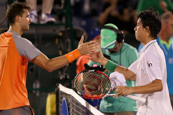 KEY BISCAYNE, FL - MARCH 23:  Kei Nishikori of Japan shakes hands at the net after his straight sets victory against Grigor Dimitrov of Bulgaria during their third round match during day 7 at the Sony Open at Crandon Park Tennis Center on March 23, 2014 in Key Biscayne, Florida.  (Photo by Clive Brunskill/Getty Images)