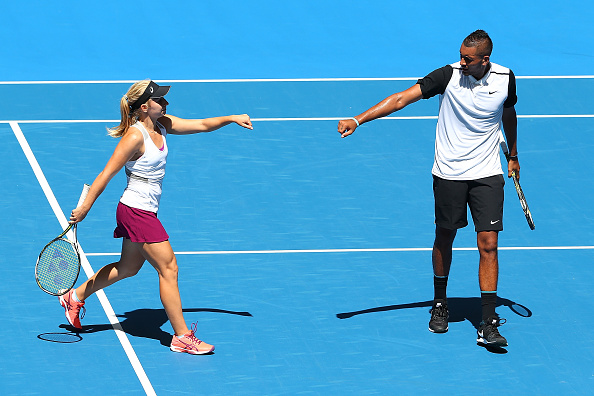 PERTH, AUSTRALIA - JANUARY 03: Daria Gavrilova and Nick Kyrgios of Australia Green celebrate winning a game in the mixed doubles match against Alexander Zverev and Sabine Lisicki of Germany during day one of the 2016 Hopman Cup at Perth Arena on January 3, 2016 in Perth, Australia.  (Photo by Paul Kane/Getty Images)