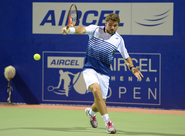 CHENNAI, INDIA - JANUARY 7: Swiss tennis player Stan Wawrinka in action during the match against Crotian player Borna Coric during ATP Chennai Open tennis tournament at SDAT Stadium on January 7, 2015 in Chennai, India. (Photo by Subhankar Chakraborty/Hindustan Times via Getty Images)
