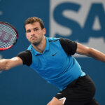 BRISBANE, AUSTRALIA - JANUARY 04:  Grigor Dimitrov of Bulgaria plays a forehand against Gilles Simon of France during day two of the 2016 Brisbane International at Pat Rafter Arena on January 4, 2016 in Brisbane, Australia.  (Photo by Matt Roberts/Getty Images)