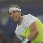 NEW DELHI, INDIA - DECEMBER 12: Rafael Nadal of Micromax Indian Aces in action against Roger Federer of Obi UAE Royals during the Coca-Cola International Premier Tennis League at IG Stadium on December 12, 2015 in New Delhi, India. (Photo by Virendra Singh Gosain/Hindustan Times via Getty Images)