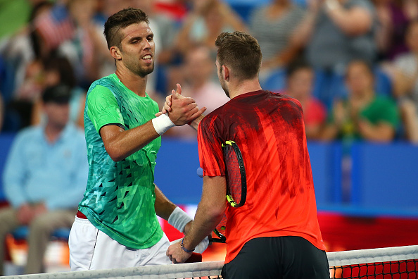 PERTH, AUSTRALIA - JANUARY 07:  Jiri Vesely of the Czech Republic congratulates Jack Sock of the United States on winning the mens singles match during day five of the 2016 Hopman Cup at Perth Arena on January 7, 2016 in Perth, Australia.  (Photo by Paul Kane/Getty Images)