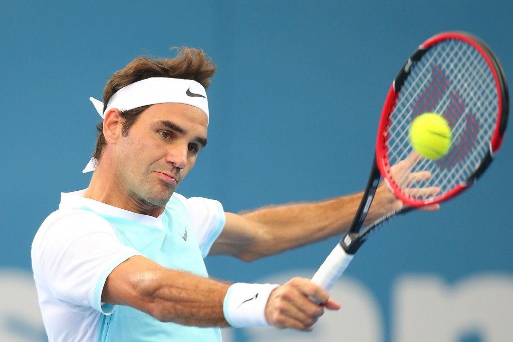 BRISBANE, AUSTRALIA - JANUARY 09:  Roger Federer of Switzerland plays a backhand in his semi final match against Dominic Thiem of Austria during day seven of the 2016 Brisbane International at Pat Rafter Arena on January 9, 2016 in Brisbane, Australia.  (Photo by Chris Hyde/Getty Images)