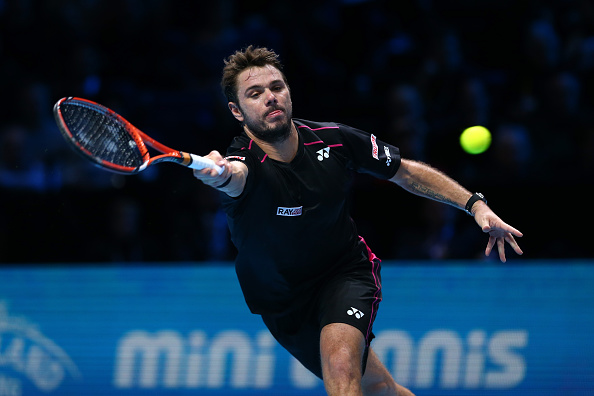 LONDON, ENGLAND - NOVEMBER 21:  Stanislas Wawrinka of Switzerland plays a forehand in his men's semi final against Roger Federer of Switzerland on day seven of the Barclays ATP World Tour Finals at the O2 Arena on November 21, 2015 in London, England.  (Photo by Clive Brunskill/Getty Images)