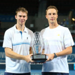 BRISBANE, AUSTRALIA - JANUARY 10:  John Peers of Australia and Henri Kontinen of Finland hold the winners trophy after winning the Mens Doubles Final against Chris Guccione of Australia and James Duckworth of Australia during day eight of the 2016 Brisbane International at Pat Rafter Arena on January 10, 2016 in Brisbane, Australia.  (Photo by Chris Hyde/Getty Images)