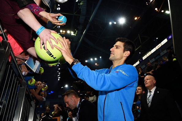 LONDON, ENGLAND - NOVEMBER 22: Novak Djokovic of Serbia with fans after his championship win against Roger Federer of switzerland at the Barclays ATP World Tour Finals at O2 Arena on November 22, 2015 in London, England.  (Photo by Peter Staples/ATP World Tour/ATP via Getty Images).