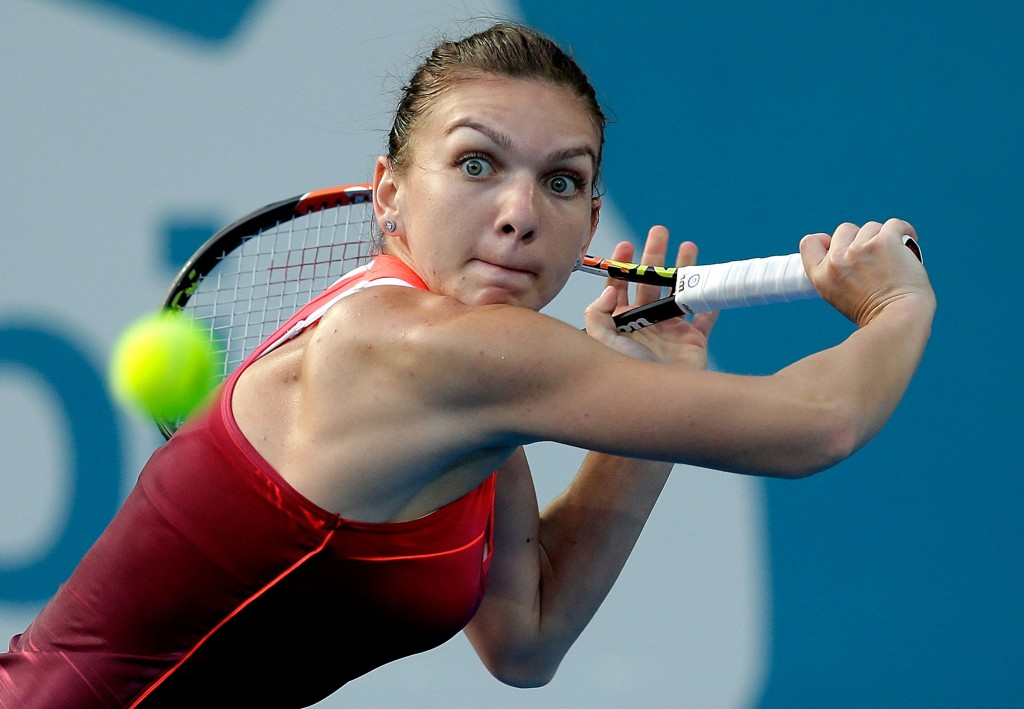 SYDNEY, AUSTRALIA - JANUARY 12:  Simona Halep of Romania plays a backhand in her match against Caroline Garcia of France during day three of the 2016 Sydney International at Sydney Olympic Park Tennis Centre on January 12, 2016 in Sydney, Australia.  (Photo by Mark Metcalfe/Getty Images)