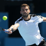 SYDNEY, AUSTRALIA - JANUARY 13:  Grigor Dimitrov of Bulgaria plays a forehand in his match against Pablo Cuevas of Uruguay during day four of the Sydney International at Sydney Olympic Park Tennis Centre on January 13, 2016 in Sydney, Australia.  (Photo by Mark Metcalfe/Getty Images)