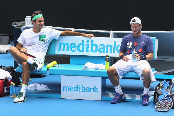 MELBOURNE, AUSTRALIA - JANUARY 15:  Roger Federer of Switzerland (L) talks with Lleyton Hewitt of Australia during a practice session ahead of the 2016 Australian Open at Melbourne Park on January 15, 2016 in Melbourne, Australia.  (Photo by Michael Dodge/Getty Images)