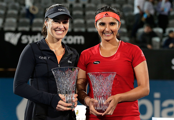 SYDNEY, AUSTRALIA - JANUARY 15:  Martina Hingis of Switzerland (L) and Sania Mirza of India (R) celebrate and pose after winning the womens doubles final against Kristina Mladenovic and Caroline Garcia of France during day six of the 2016 Sydney International at Sydney Olympic Park Tennis Centre on January 15, 2016 in Sydney, Australia.  (Photo by Mark Metcalfe/Getty Images)