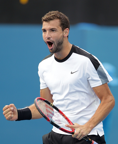 SYDNEY, AUSTRALIA - JANUARY 15:  Grigor Dimitrov of Bulgaria celebrates winning match point in his semi final match against Gilles Muller of Luxembourg during day six of the 2016 Sydney International at Sydney Olympic Park Tennis Centre on January 15, 2016 in Sydney, Australia.  (Photo by Mark Metcalfe/Getty Images)