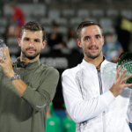 SYDNEY, AUSTRALIA - JANUARY 16:  Viktor Troicki of Serbia poses with the winners trophy and Grigor Dimitrov of Bulgaria the runners up trophy after the men's doubles final during day seven of the 2016 Sydney International at Sydney Olympic Park Tennis Centre on January 16, 2016 in Sydney, Australia.  (Photo by Mark Metcalfe/Getty Images)