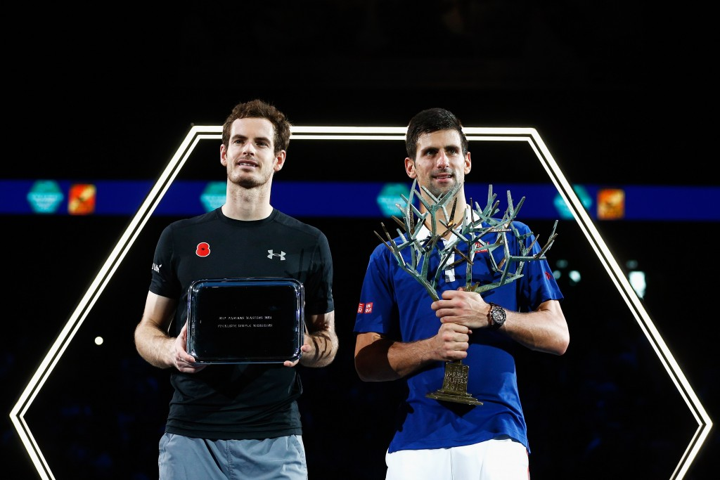 PARIS, FRANCE - NOVEMBER 08:  Novak Djokovic (R) of Serbia lifts the winners trophy after victory against Andy Murray (L) of Great Britain after their Mens Final match during Day 7 of the BNP Paribas Masters held at AccorHotels Arena on November 8, 2015 in Paris, France.  (Photo by Dean Mouhtaropoulos/Getty Images)