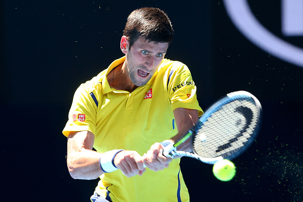 MELBOURNE, AUSTRALIA - JANUARY 18:  Novak Djokovic of Serbia plays a backhand in his first round match against Hyeon Chung of Korea during day one of the 2016 Australian Open at Melbourne Park on January 18, 2016 in Melbourne, Australia.  (Photo by Quinn Rooney/Getty Images)