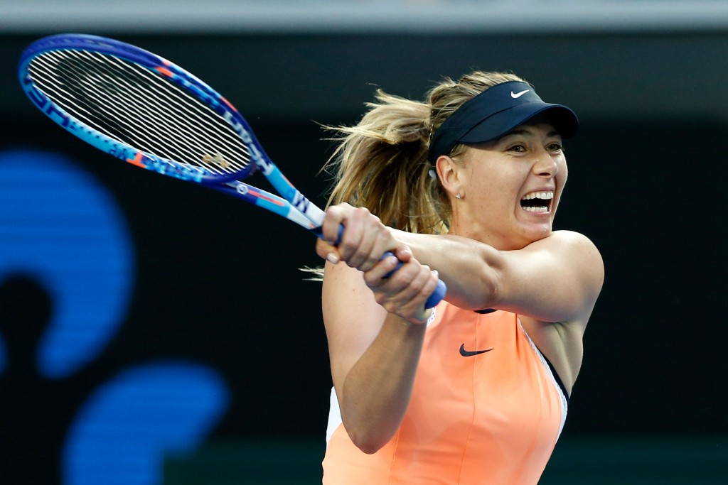 MELBOURNE, AUSTRALIA - JANUARY 18:  Maria Sharapova of Russia plays a backhand in her first round match against Nao Hibino of Japan during day one of the 2016 Australian Open at Melbourne Park on January 18, 2016 in Melbourne, Australia.  (Photo by Zak Kaczmarek/Getty Images)