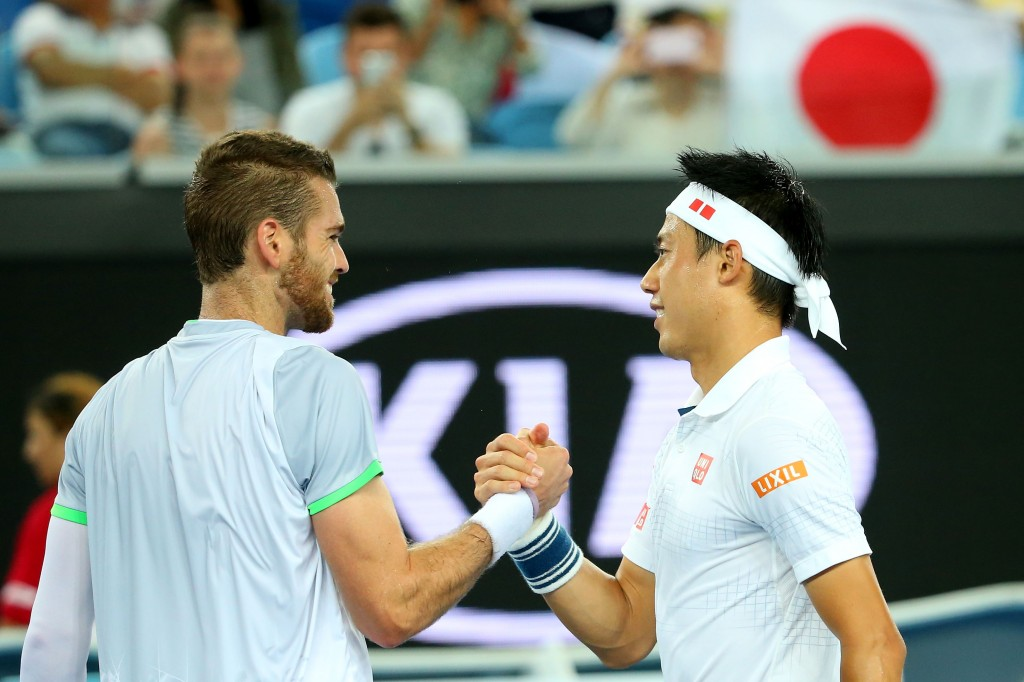 MELBOURNE, AUSTRALIA - JANUARY 20:  Kei Nishikori of Japan shakes hands with Austin Krajicek of the United States in their second round match during day three of the 2016 Australian Open at Melbourne Park on January 20, 2016 in Melbourne, Australia.  (Photo by Quinn Rooney/Getty Images)