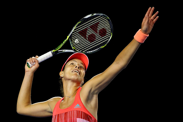 XXX of ZZZ plays a forehand in his/her second round match against XXXX of ZZZZ during day four of the 2016 Australian Open at Melbourne Park on January 21, 2016 in Melbourne, Australia.