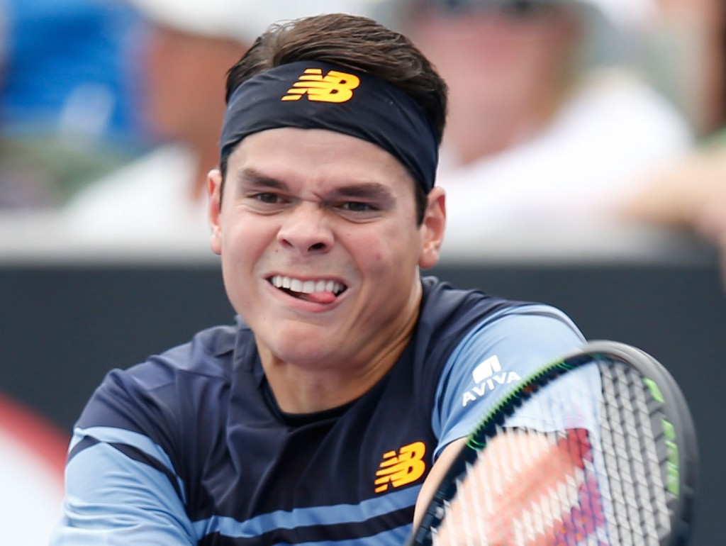 MELBOURNE, AUSTRALIA - JANUARY 21:  Milos Raonic of Canada plays a backhand in his second round match against Tommy Robredo of Spain during day four of the 2016 Australian Open at Melbourne Park on January 21, 2016 in Melbourne, Australia.  (Photo by Darrian Traynor/Getty Images)