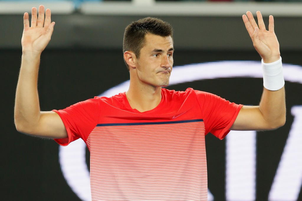 MELBOURNE, AUSTRALIA - JANUARY 21:  Bernard Tomic of Australia acknowledges the fans after winning his second round match against Simone Bolelli of Italy during day four of the 2016 Australian Open at Melbourne Park on January 21, 2016 in Melbourne, Australia.  (Photo by Darrian Traynor/Getty Images)