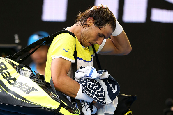 XXX of ZZZ plays a forehand in his/her first round match against XXXX of ZZZZ during day two of the 2016 Australian Open at Melbourne Park on January 19, 2016 in Melbourne, Australia.