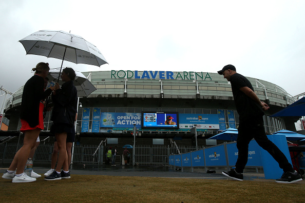 MELBOURNE, AUSTRALIA - JANUARY 22:  Patrons arrive at Rod Laver Arena in the rain during day five of the 2016 Australian Open at Melbourne Park on January 22, 2016 in Melbourne, Australia.  (Photo by Pat Scala/Getty Images)