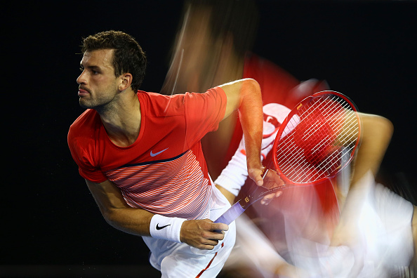 MELBOURNE, AUSTRALIA - JANUARY 22:  (EDITORS NOTE: Multiple exposures were combined in camera to produce this image.) Grigor Dimitrov of Bulgaria serves in his third round match against Roger Federer of Switzerland during day five of the 2016 Australian Open at Melbourne Park on January 22, 2016 in Melbourne, Australia.  (Photo by Ryan Pierse/Getty Images)