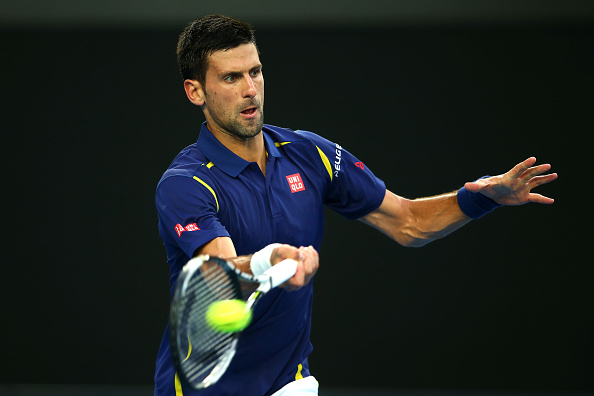 MELBOURNE, AUSTRALIA - JANUARY 22:  Novak Djokovic of Serbia plays a backhand in his third round match against Andreas Seppi of Italy during day five of the 2016 Australian Open at Melbourne Park on January 22, 2016 in Melbourne, Australia.  (Photo by Mark Kolbe/Getty Images)