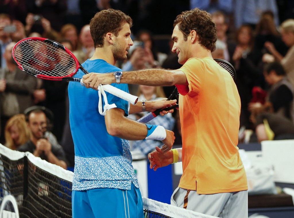 NEW YORK - MARCH 10:  Grigor Dimitrov of Bulgaria greets Roger Federer of Switzerland during the BNP Paribas Showdown at Madison Square Garden on March 10, 2015 in New York City.  (Photo by Rich Schultz /Getty Images)