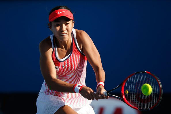 MELBOURNE, AUSTRALIA - JANUARY 21:  Shuai Zhang of China plays a backhand in her second round match against Alize Cornet of France during day four of the 2016 Australian Open at Melbourne Park on January 21, 2016 in Melbourne, Australia.  (Photo by Darrian Traynor/Getty Images)