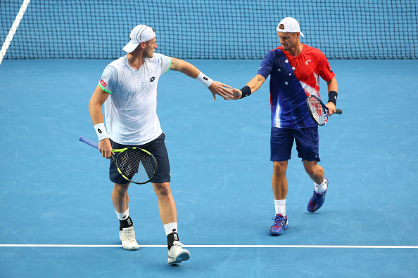 MELBOURNE, AUSTRALIA - JANUARY 23:  Sam Groth of Australia and Lleyton Hewitt of Australia celebrate a point in their second round doubles match against Henri Kontinen of Finland and John Peers of Australia during day six of the 2016 Australian Open at Melbourne Park on January 23, 2016 in Melbourne, Australia.  (Photo by Quinn Rooney/Getty Images)