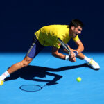 XXX of ZZZ plays a forehand in his/her fourth round match against XXXX of ZZZZ during day seven of the 2016 Australian Open at Melbourne Park on January 24, 2016 in Melbourne, Australia.