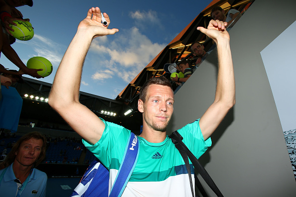 MELBOURNE, AUSTRALIA - JANUARY 24:  Tomas Berdych of the Czech Republic signs autographs for fans after winning his fourth round match against Roberto Bautista Agut of Spain during day seven of the 2016 Australian Open at Melbourne Park on January 24, 2016 in Melbourne, Australia.  (Photo by Scott Barbour/Getty Images)