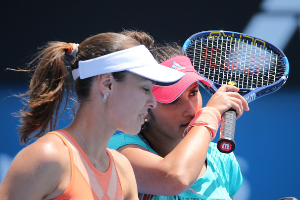 MELBOURNE, AUSTRALIA - JANUARY 23:  Martina Hingis of Switzerland and Sania Mirza of India compete in their second round match against Lyudmyla Kichenok of the Ukraine and Nadiia Kichenok of the Ukraine during day six of the 2016 Australian Open at Melbourne Park on January 23, 2016 in Melbourne, Australia.  (Photo by Michael Dodge/Getty Images)