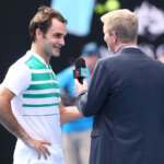 MELBOURNE, AUSTRALIA - JANUARY 26:  Roger Federer of Switzerland talks with MC Jim Courier after winning his quarter final match against Tomas Berdych of the Czech Republic during day nine of the 2016 Australian Open at Melbourne Park on January 26, 2016 in Melbourne, Australia.  (Photo by Michael Dodge/Getty Images)