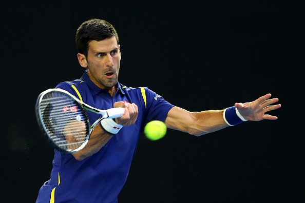 MELBOURNE, AUSTRALIA - JANUARY 26:  Novak Djokovic of Serbia plays a forehand in his quarter final match against Kei Nishikori of Japan during day nine of the 2016 Australian Open at Melbourne Park on January 26, 2016 in Melbourne, Australia.  (Photo by Quinn Rooney/Getty Images)