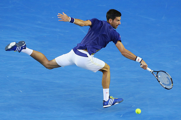 MELBOURNE, AUSTRALIA - JANUARY 26:  Novak Djokovic of Serbia plays a forehand in his quarter final match against Kei Nishikori of Japan during day nine of the 2016 Australian Open at Melbourne Park on January 26, 2016 in Melbourne, Australia.  (Photo by Michael Dodge/Getty Images)