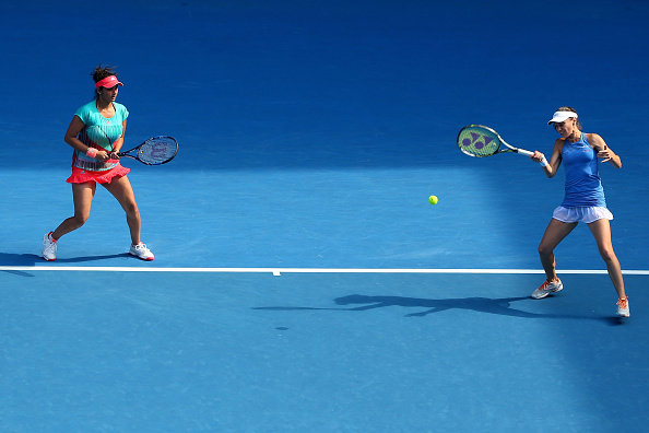 XXX of ZZZ plays a forehand in his/her fourth round match against XXXX of ZZZZ during day eight of the 2016 Australian Open at Melbourne Park on January 25, 2016 in Melbourne, Australia.