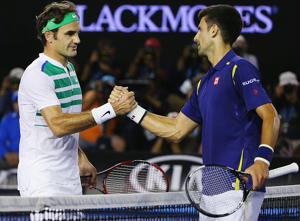 MELBOURNE, AUSTRALIA - JANUARY 28:  Novak Djokovic of Serbia (R) shakes hands after winning in his semi final match against Roger Federer of Switzerland during day 11 of the 2016 Australian Open at Melbourne Park on January 28, 2016 in Melbourne, Australia.  (Photo by Michael Dodge/Getty Images)