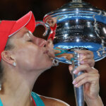 MELBOURNE, AUSTRALIA - JANUARY 30:  Angelique Kerber of Germany kisses the Daphne Akhurst Trophy after winning the Women's Singles Final against Serena Williams of the United States during day 13 of the 2016 Australian Open at Melbourne Park on January 30, 2016 in Melbourne, Australia.  (Photo by Michael Dodge/Getty Images)