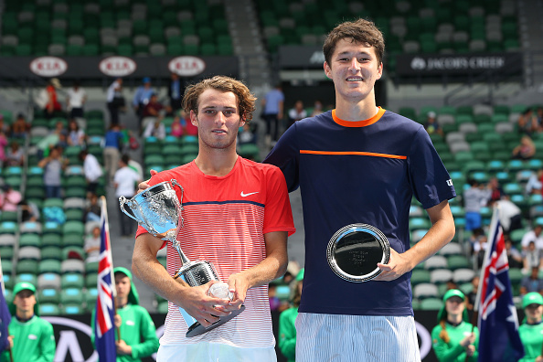 MELBOURNE, AUSTRALIA - JANUARY 30:  Oliver Anderson of Australia and Jurabeck Karimov of Uzbekistan pose with their trophies after the Junior Boys' Singles Final match during the Australian Open 2016 Junior Championships at Melbourne Park on January 30, 2016 in Melbourne, Australia.  (Photo by Michael Dodge/Getty Images)
