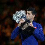 MELBOURNE, AUSTRALIA - JANUARY 31:  Novak Djokovic of Serbia kisses the Norman Brookes Challenge Cup after winning the Men's Singles Final over Andy Murray of Great Britain during day 14 of the 2016 Australian Open at Melbourne Park on January 31, 2016 in Melbourne, Australia.  (Photo by Michael Dodge/Getty Images)