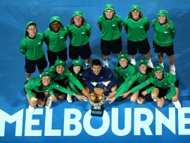 MELBOURNE, AUSTRALIA - JANUARY 31:  Novak Djokovic of Serbia poses with ball kids and the Norman Brookes Challenge Cup after winning the Men's Singles Final over Andy Murray of Great Britain during day 14 of the 2016 Australian Open at Melbourne Park on January 31, 2016 in Melbourne, Australia.  (Photo by Quinn Rooney/Getty Images)