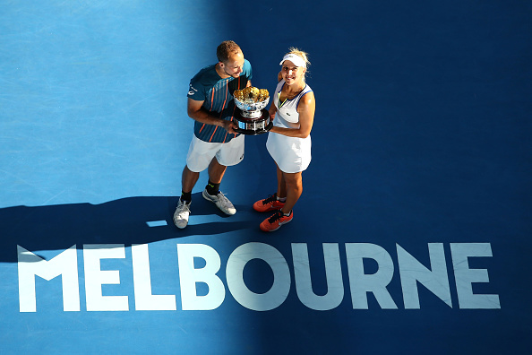 MELBOURNE, AUSTRALIA - JANUARY 31:  Elina Vesina of Russia and Brunos Soares of Brazil pose with the trophy after winning the Mixed Doubles Final match against Coco Vanderweghe of the United States and Horia Tecau of Romania during day 14 of the 2016 Australian Open at Melbourne Park on January 31, 2016 in Melbourne, Australia.  (Photo by Jack Thomas/Getty Images)