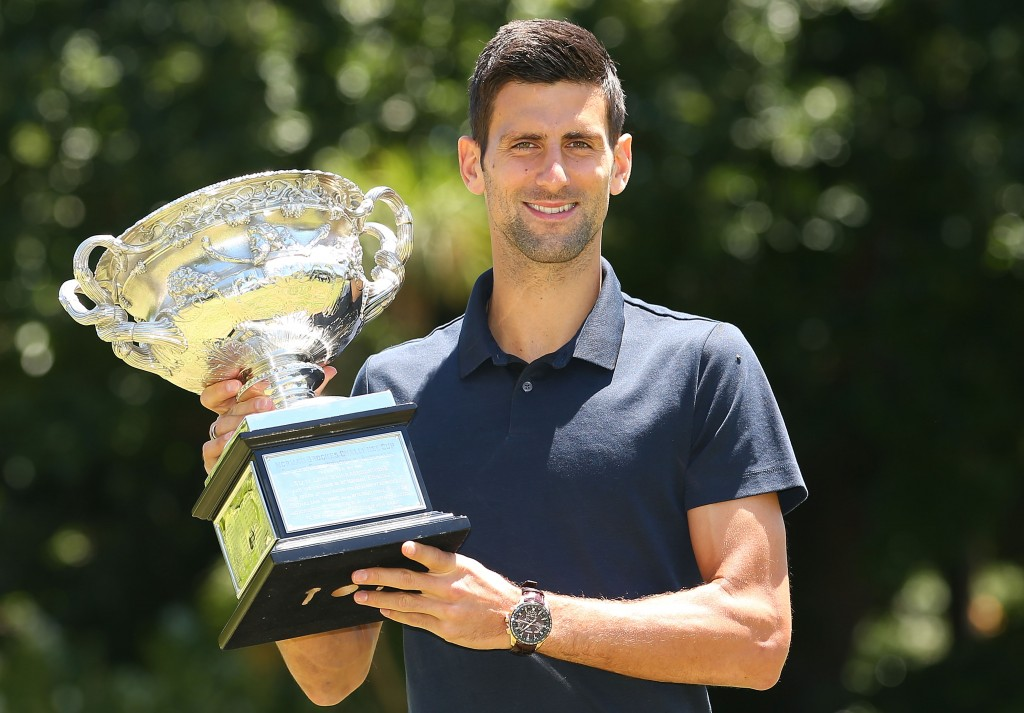 MELBOURNE, AUSTRALIA - FEBRUARY 01:  Novak Djokovic of Serbia poses with the Norman Brookes Challenge Cup after winning the Men's Singles Final during the Australian Open 2016 Men's Champion Photocall at Government House on February 1, 2016 in Melbourne, Australia.  (Photo by Scott Barbour/Getty Images)