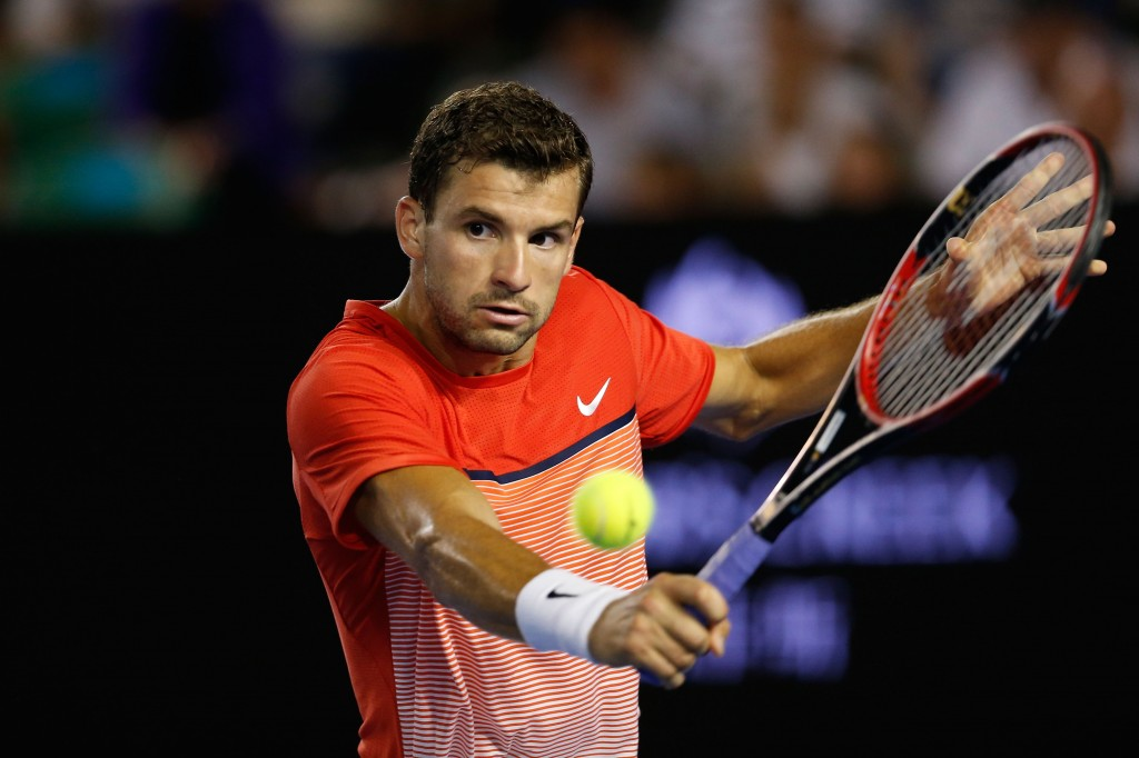 MELBOURNE, AUSTRALIA - JANUARY 22:  Grigor Dimitrov of Bulgaria plays a backhand in his third round match against Roger Federer of Switzerland during day five of the 2016 Australian Open at Melbourne Park on January 22, 2016 in Melbourne, Australia.  (Photo by Zak Kaczmarek/Getty Images)