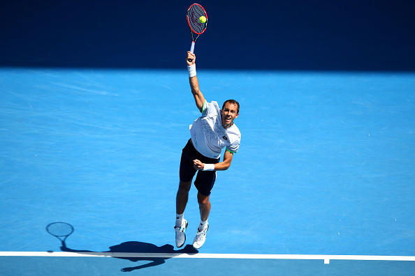 MELBOURNE, AUSTRALIA - JANUARY 23:  Lukas Rosol of the Czech Republic serves in his third round match against Stan Wawrinka of Switzerland during day six of the 2016 Australian Open at Melbourne Park on January 23, 2016 in Melbourne, Australia.  (Photo by Mark Kolbe/Getty Images)